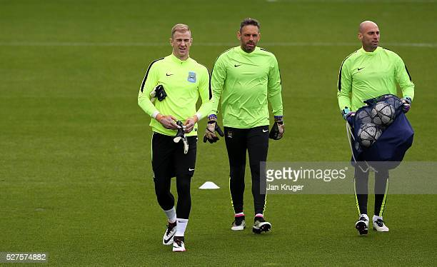 Joe Hart of Manchester City Richard Wright of Manchester City and Wilfredo Caballero of Manchester City make their way onto the field during a...