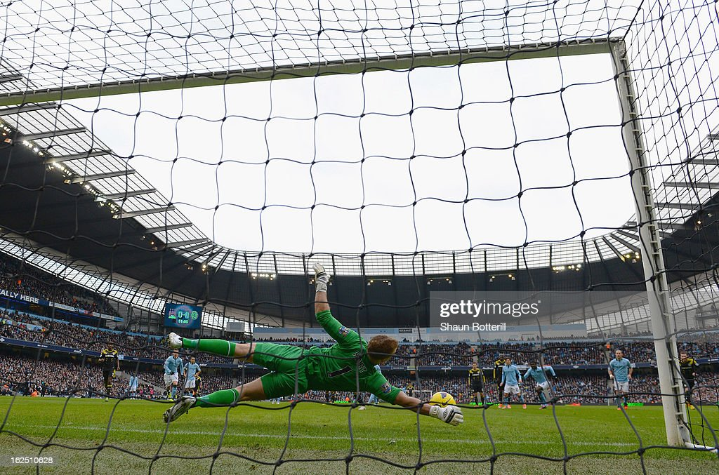 Joe Hart of Manchester City saves a penalty from Frank Lampard of Chelsea penalty during the Barclays Premier League match between Manchester City and Chelsea at Etihad Stadium on February 24, 2013 in Manchester, England.
