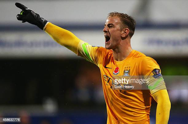 Joe Hart of Manchester City shouts during the Barclays Premier League match between Queens Park Rangers and Manchester City at Loftus Road on...