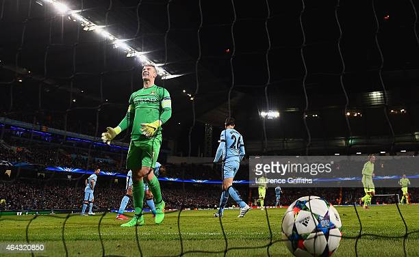 Joe Hart of Manchester City shows his frustration after Luis Suarez of Barcelona scored a second goal during the UEFA Champions League Round of 16...