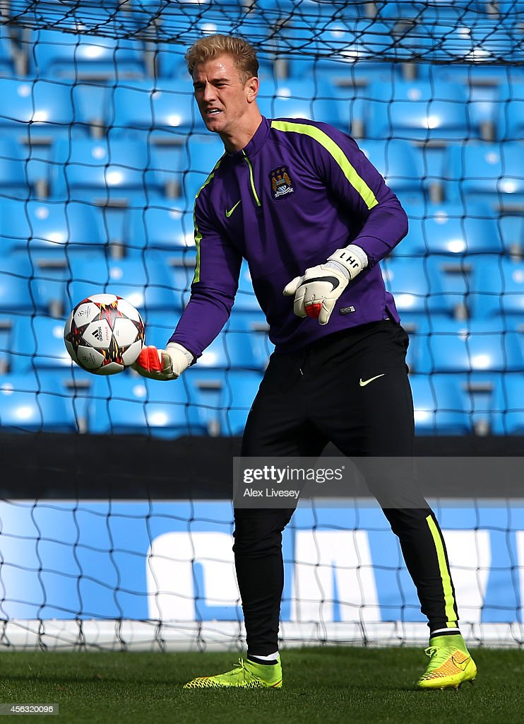 Joe Hart of Manchester City warms up during a training session at the Etihad Stadium on September 29, 2014 in Manchester, England.