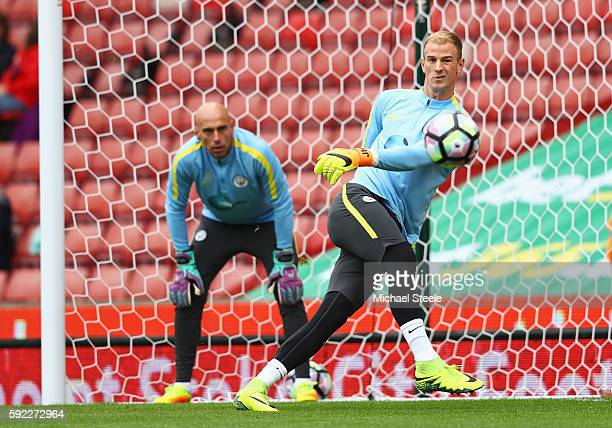 Joe Hart of Manchester City warms up with team mate Willy Cabellero of Manchester City during the Premier League match between Stoke City and...