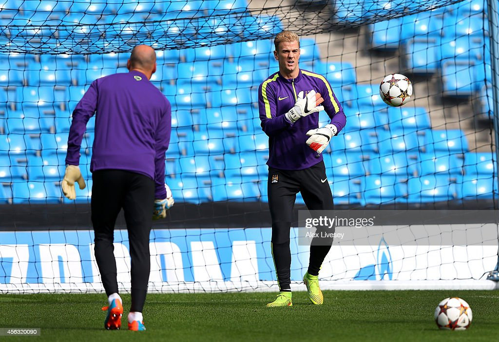 Joe Hart of Manchester City warms up with Willy Caballero during a training session at the Etihad Stadium on September 29, 2014 in Manchester, England.