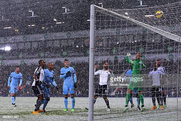 Joe Hart of Manchester City watches as the ball drops behind onto the roof of the net during the Barclays Premier League match between West Bromwich...