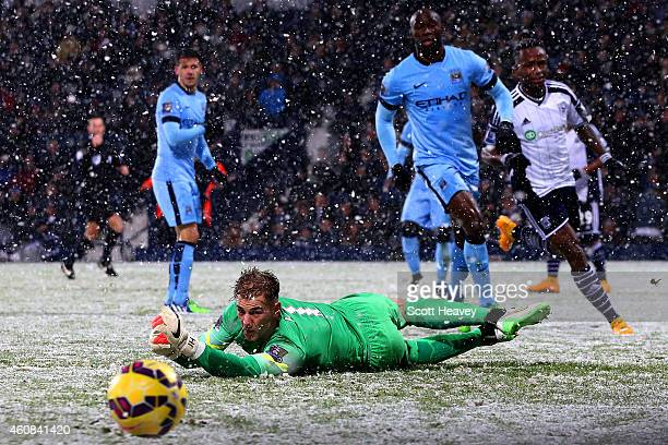 Joe Hart of Manchester City watches the ball fly past during the Barclays Premier League match between West Bromwich Albion and Manchester City at...
