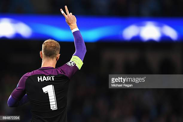 Joe Hart of Manchester City waves to fans after the UEFA Champions League Playoff Second Leg match between Manchester City and Steaua Bucharest at...