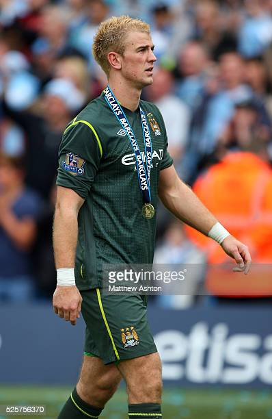 Joe Hart of Manchester City wearing his Barclays Premier League winners medal