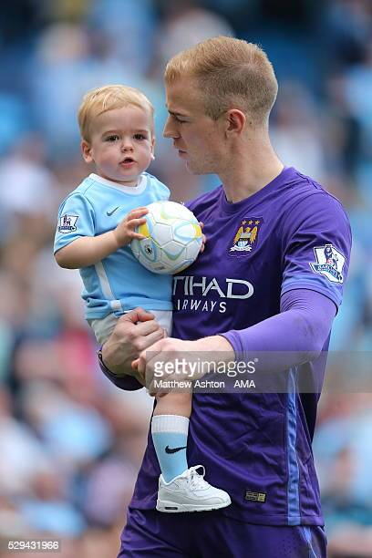 Joe Hart of Manchester City with his son Harlow Hart after the Barclays Premier League match between Manchester City and Arsenal at the Ethiad...