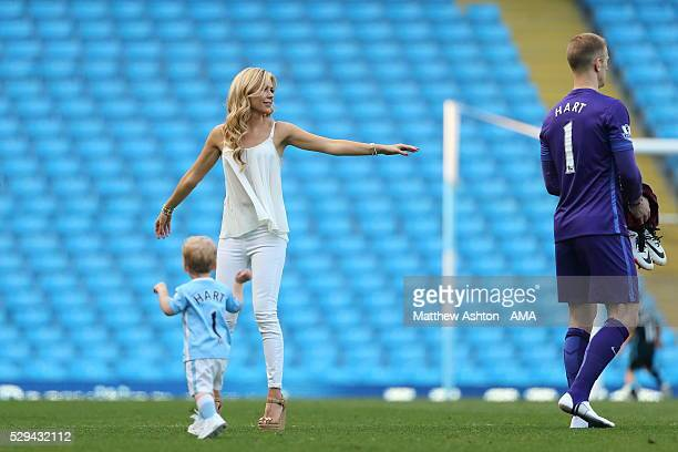 Joe Hart of Manchester City with his son Harlow Hart and wife Kimberly Crew after the Barclays Premier League match between Manchester City and...