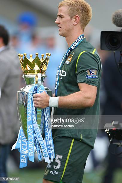 Joe Hart of Manchester City with the Barclays Premier League Trophy