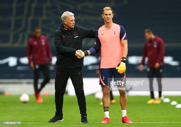 Joe Hart of Tottenham Hotspur shakes hands with David Moyes Manager of West Ham United prior to the Premier League match between Tottenham Hotspur...