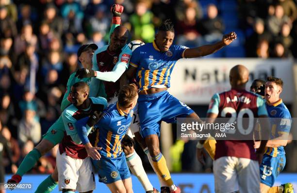 Joe Hart of West Ham United and Omar Beckles of Shrewsbury Town during The Emirates FA Cup Third Round between Shrewsbury Town and West Ham United at...