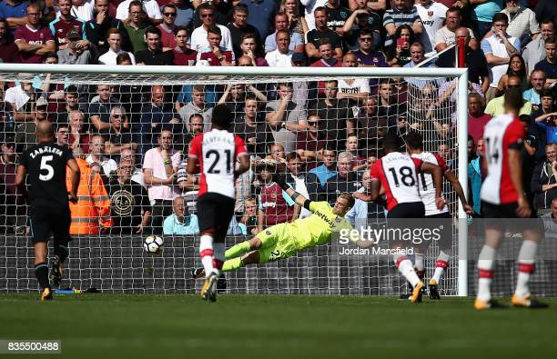Joe Hart of West Ham United dives but is beaten by Dusan Tadic of Southampton for Southampton's second goal of the game during the Premier League...