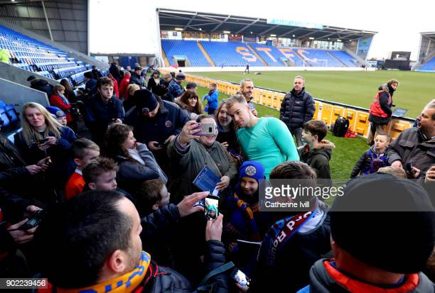 Joe Hart of West Ham United signs autographs for the Shrewsbury Town fans after the Emirates FA Cup Third Round match between Shrewsbury Town and...