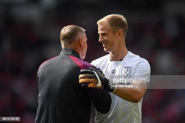 Joe Hart of West Ham United speaks to Chris Woods , West Ham United goalkeeper coach prior to the Premier League match between Manchester United and...