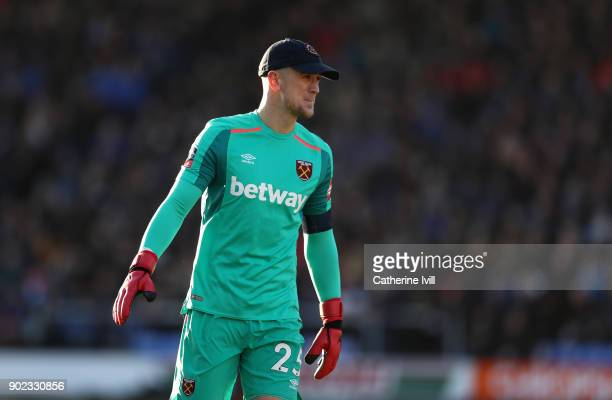 Joe Hart of West Ham United wearing a cap he borrowed from a fan during the Emirates FA Cup Third Round match between Shrewsbury Town and West Ham...
