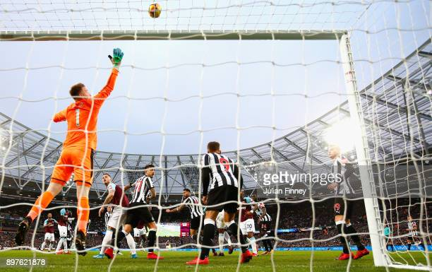 Joe Hart of West Ham watches the ball go over the bar during the Premier League match between West Ham United and Newcastle United at London Stadium...