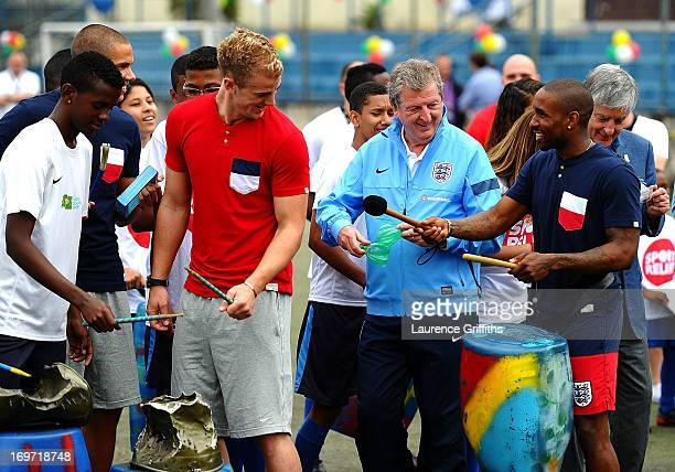 Joe Hart Roy Hodgson and Jermain Defoe of England play the drums with local children during a visit to a Sport Relief project on May 31 2013 in Rio...