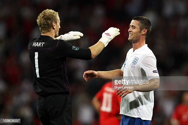 Joe Hart the England goalkeeper celebrates with team mate Phil Jagielka during the UEFA EURO 2012 Group G Qualifying match between England and...