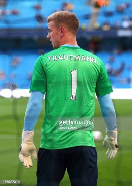 Joe Hart the goalkeeper of Manchester City wears the name of Bert Trautmann on his shirt as he warms up in memory of the former goalkeeper who died...