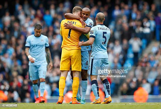 Joe Hart Vincent Kompany and Pablo Zabaleta of Manchester City celebrate after the Barclays Premier League match between Manchester City and...