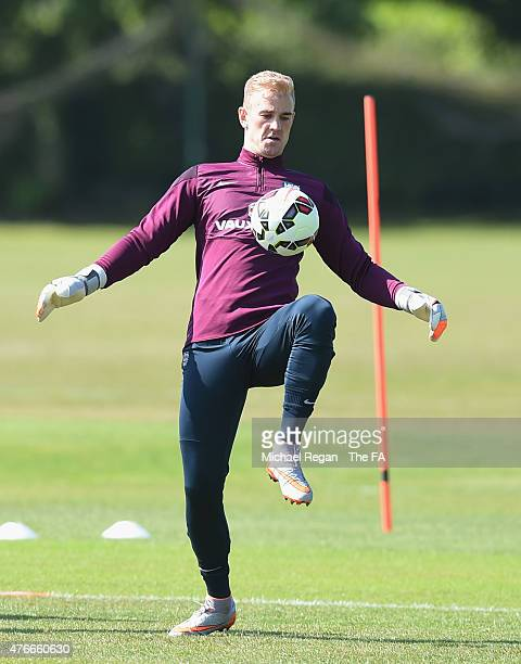 Joe Hart warms up during the England training session on June 11, 2015 in St Albans, England.