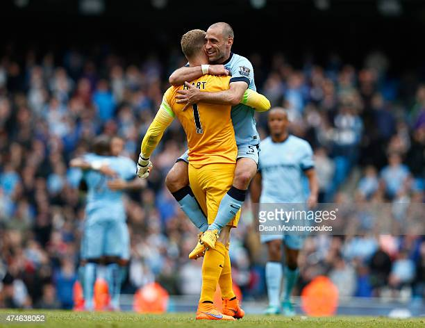Joe Hartand Pablo Zabaleta of Manchester City celebrate after the Barclays Premier League match between Manchester City and Southampton at Etihad...