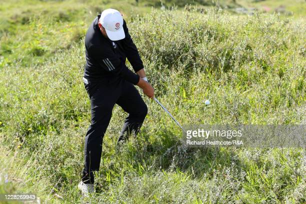 Joe Harvey of England hits from the rough on the 11th hole in the afternoon round during the Final on Day Six of the Amateur Championship at Royal...