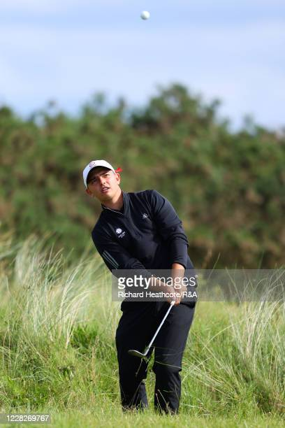 Joe Harvey of England pitches on the 8th hole in the afternoon round during the Final on Day Six of the Amateur Championship at Royal Birkdale on...