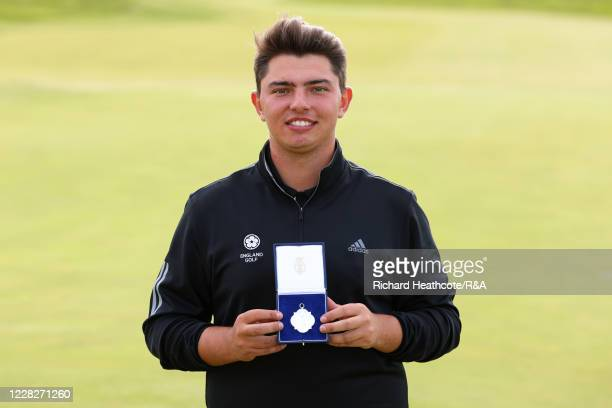 Joe Harvey of England poses with the silver runners up medal after the Final on Day Six of the Amateur Championship at Royal Birkdale on August 30,...