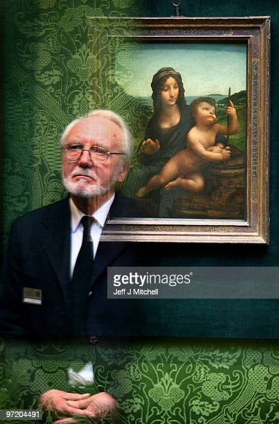 Joe Hay security guard at the National Gallery of Scotland stands beside the Leonardo da Vinci painting 'Madonna Of The Yarnwinder' on March 1 2010...