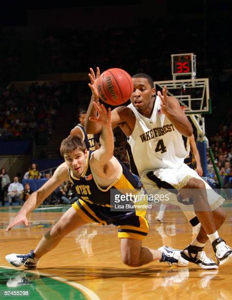 Joe Herber of the West Virginia Mountaineers battles Taron Downey of the Wake Forest Demon Deacons for a loose ball during the second round of the...