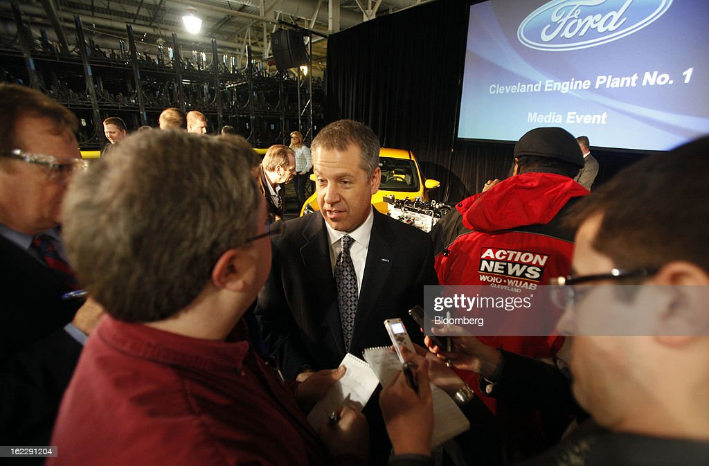 Joe Hinrichs, president of the Americas for Ford Motor Co., center, speaks to the media during an event at the company's Cleveland Engine Plant in Brook Park, Ohio, U.S., on Thursday, Feb. 21, 2013. Ford Motor Co. said it will invest $200 million to make four-cylinder engines at the plant starting in late 2014 as the second-largest U.S. automaker equips an increasing number of models with smaller, more fuel-efficient powertrains. Photographer: David Maxwell/Bloomberg via Getty Images