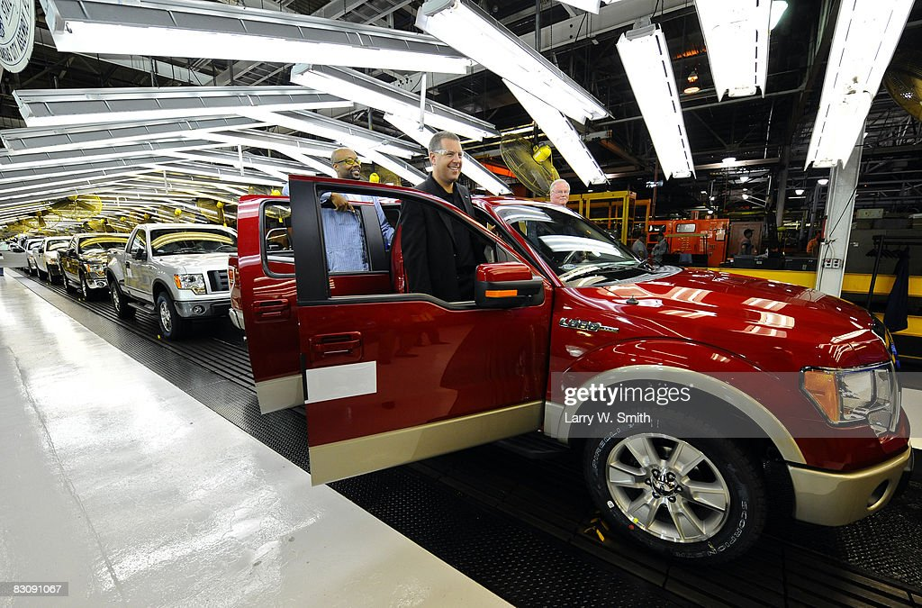 Joe Hinrichs, VP of Global Mfg. and Labor Affairs (R) and Gregory Armstrong, a 17-year Ford employee, stand in the doors of a Ford F-150 Lobo pickup on the final assembly line at the Kansas City Ford Assembly plant October 2, 2008 in Claycomo, Missouri. Ford's Kansas City Assembly plant celebrates production of the new 2009 Ford F-150 with the official roll out.