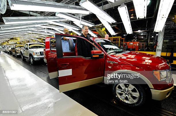 Joe Hinrichs VP of Global Mfg and Labor Affairs and Gregory Armstrong a 17year Ford employee stand in the doors of a Ford F150 Lobo pickup on the...