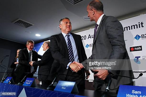 Joe Hockey Australian Treasurer and John Rice CEO GE Global Growth shake hands following a press conference during the B20 Summit at on July 18 2014...