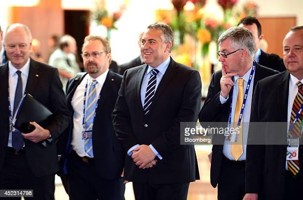 Joe Hockey, Australia's treasurer, center, arrives at the B20 Australia Summit in Sydney, Australia, on Friday, July 18, 2014. Business leaders from...