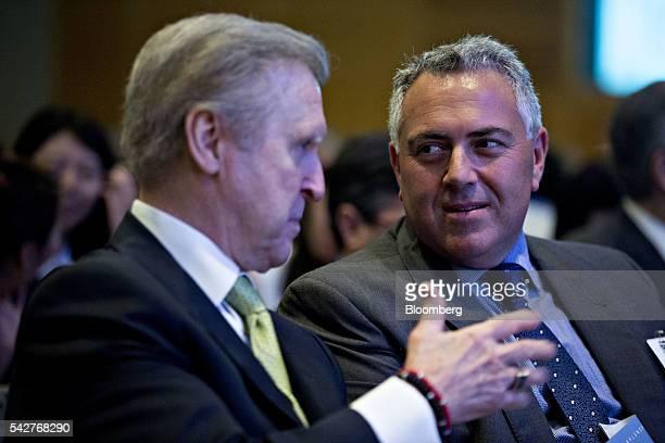 Joe Hockey, former treasurer of Australia and Australias ambassador to the U.S., right, talks to William Cohen, chairman and chief executive officer...