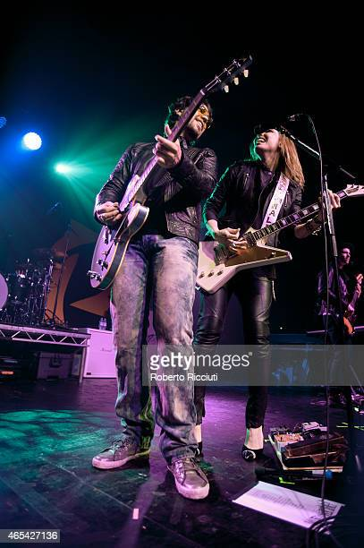 Joe Hottinger and Lzzy Hale of Halestorm perform on stage at Barrowlands Ballroom on March 6, 2015 in Glasgow, United Kingdom.