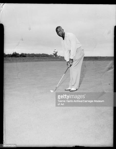 Joe Hudson chairman of the Eastern Open at South Park golf course holding golf club Allegheny County Pennsylvania 1941