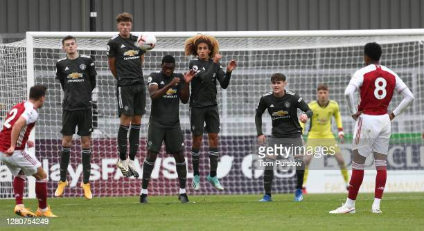 Joe Hugill Will Fish Teden Mengi Hannibal Mejbri Mark Helm of Manchester United U23s defend a free kick during the Premier League 2 match between...