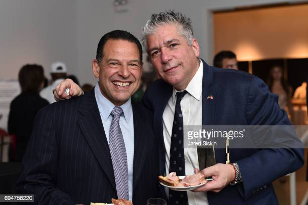 Joe Imbriale and Gus Michael Farianella attend the 21st Annual Hamptons Heart Ball at Southampton Arts Center on June 10 2017 in Southampton New York