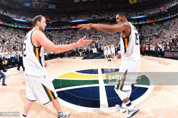 Joe Ingles and Derrick Favors of the Utah Jazz high five each other after the game against the LA Clippers in Game Four during the Western Conference...