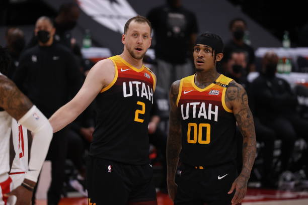 Joe Ingles and Jordan Clarkson of the Utah Jazz look on during the game against the LA Clippers during Round 2, Game 5 of the 2021 NBA Playoffs on...