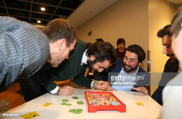 Joe Ingles and Ricky Rubio of the Utah Jazz play the game operation during Game Night with the Jazz at vivintSmartHome Arena on October 05 2017 in...