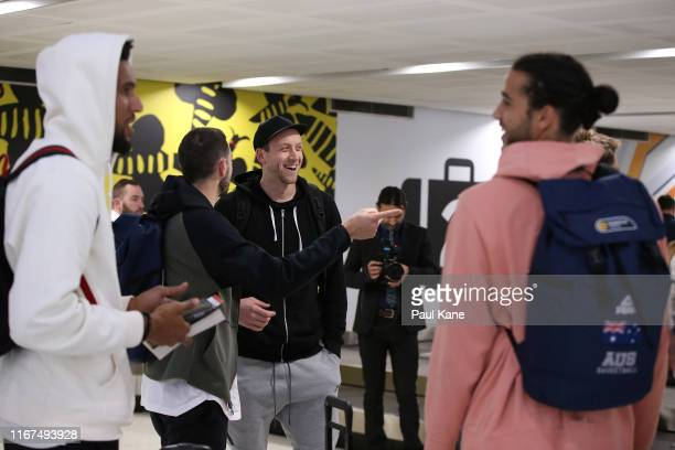 Joe Ingles of the Boomers looks on with Chris Goulding after arriving at Perth Airport on August 12, 2019 in Perth, Australia.