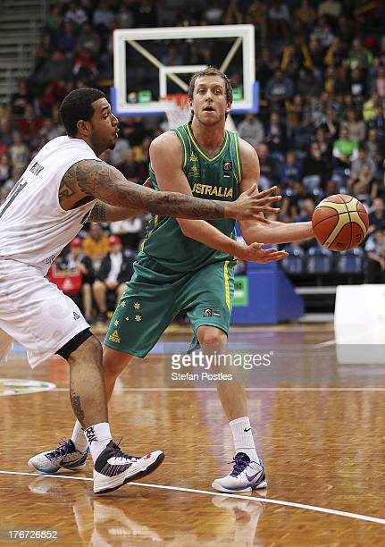 Joe Ingles of the Boomers passes the ball during the Men's FIBA Oceania Championship match between the Australian Boomers and the New Zealand Tall...