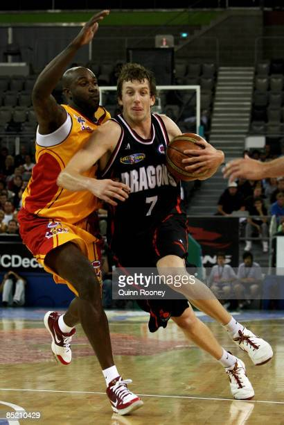 Joe Ingles of the Dragons attempts to get passed Ebi Ere of the Tigers during the game one NBL final match between the South Dragons and the...