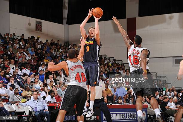 Joe Ingles of the Golden State Warriors shoots over James Augustine and James Johnson of the Chicago Bulls during NBA Summer League presented by EA...