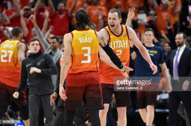 Joe Ingles of the Utah Jazz and Ricky Rubio react to Rubio's basket at the end of the third quarter during Game Three of Round One of the 2018 NBA...